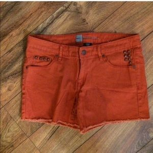 Shorts with studs on pockets